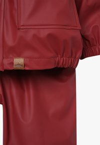 mikk-line - RAIN SET 2-IN-1 - Waterproof jacket - burnt russet - 5