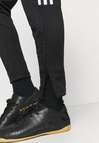 adidas Performance - TIRO  - Pantalones deportivos - black - 3