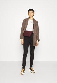 Calvin Klein Jeans - HIGH RISE  - Skinny džíny - eternal black - 1