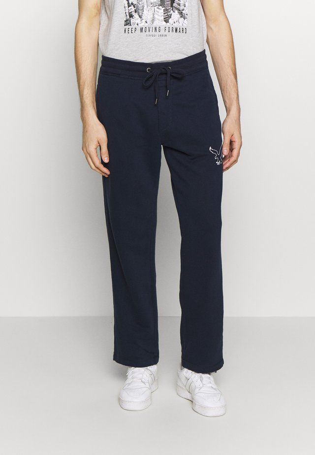 RELAXED - Tracksuit bottoms - somber navy