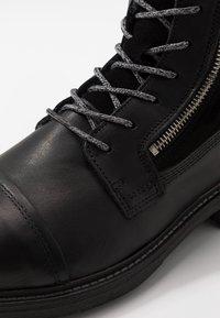 Steve Madden - Šněrovací kotníkové boty - black - 5