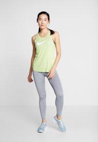 Nike Performance - TANK RUN - Camiseta de deporte - limelight/white - 1
