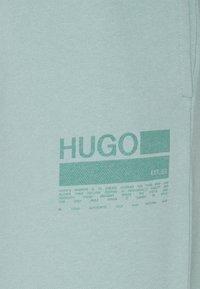 HUGO - NAJOGGER - Tracksuit bottoms - light/pastel green - 2