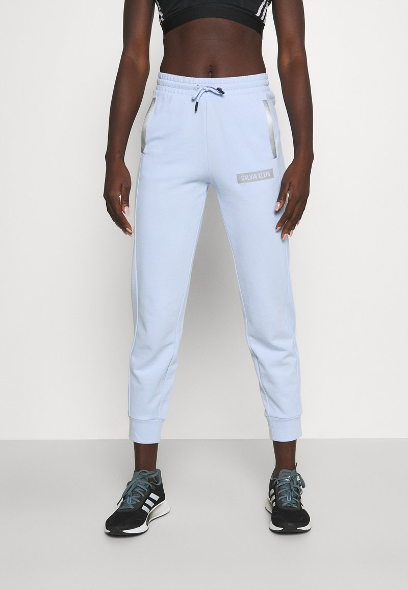 Calvin Klein Performance - PANTS - Tracksuit bottoms - sweet blue