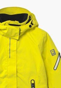 Reima - WINTER FROST UNISEX - Laskettelutakki - lemon yellow - 4