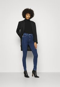 Guess - LUSH  - Jeans Skinny Fit - blue denim - 1