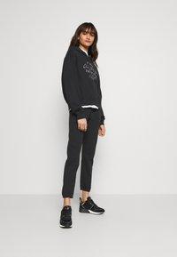 Replay - ROSE COLLECTION PANTS - Pantaloni sportivi - black - 3