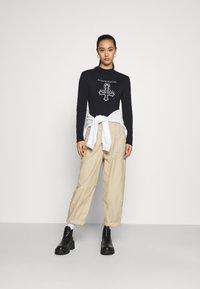 Missguided - HALLOWEEN BLACK MAGIC GRAPHIC BODYSUIT - Long sleeved top - black - 1