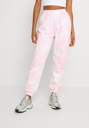 JACKIE - Tracksuit bottoms - pink tie dye