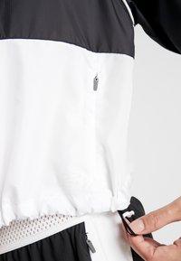 New Balance - VELOCITY JACKET - Sports jacket - black/white - 5