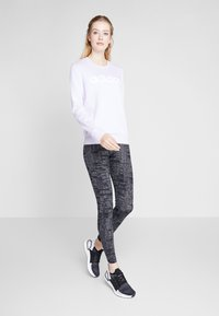 adidas Performance - ESSENTIALS SEASONAL SPORT LEGGINGS - Punčochy - black - 1
