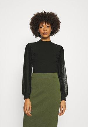ODILYA - Long sleeved top - noir
