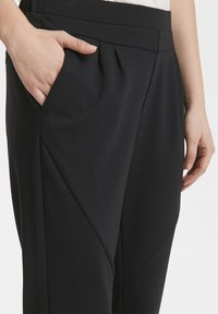 Cream - ANETT PANTS - Trousers - pitch black - 5