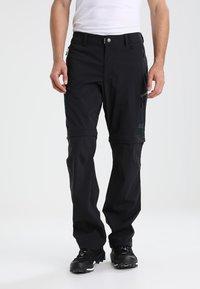 Jack Wolfskin - ACTIVATE LIGHT ZIP OFF - Outdoor trousers - black - 0