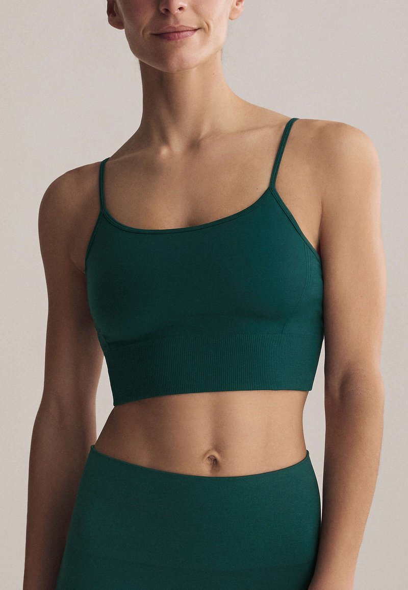 OYSHO - Light support sports bra - evergreen