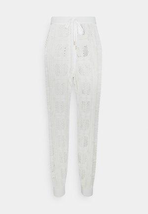 PANTALONE IN MAGLIA TRAFORATA - Kangashousut - off white