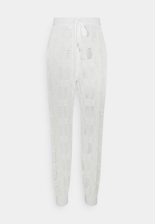 PANTALONE IN MAGLIA TRAFORATA - Trousers - off white