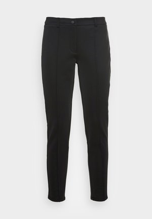 CARANA - Trousers - black