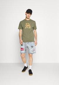The Couture Club - BANDANA PATCH AND PAINT SPLAT CUT OFFS - Denim shorts - vintage blue - 1