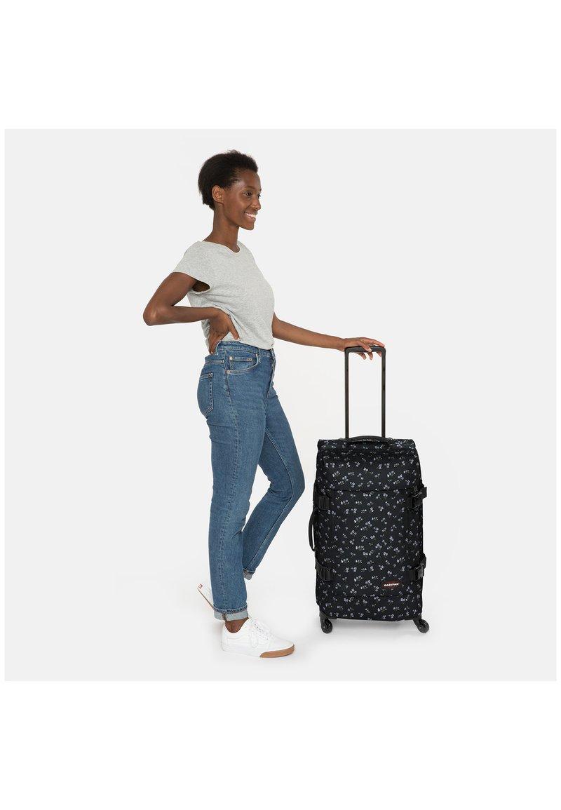 Eastpak - TRANS4 M - Wheeled suitcase - bliss dark
