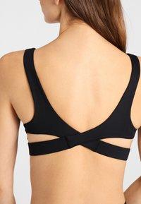 Daquïni - BH INFINITY  - Light support sports bra - black - 2
