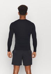 ODLO - PERFORMANCE WARM ECO CREW NECK - Unterhemd/-shirt - black/new odlo graphite grey - 2