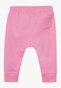 MOSCHINO - Teplákové kalhoty - dark pink - 1