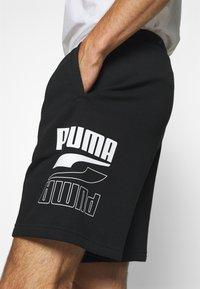 Puma - REBEL SHORTS - Träningsshorts - black - 4