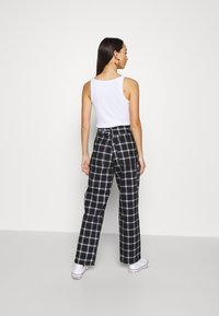 Topshop - CHECK CARPENTER - Trousers - navy - 2