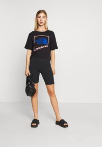 The North Face - EXTREME CROP TEE - Print T-shirt - black - 1