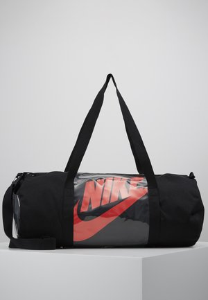 HERITAGE - Sports bag - black/laser crimson