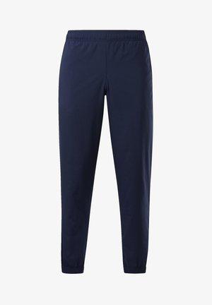 TRAINING ESSENTIALS WOVEN CUFFED PANTS - Jogginghose - blue
