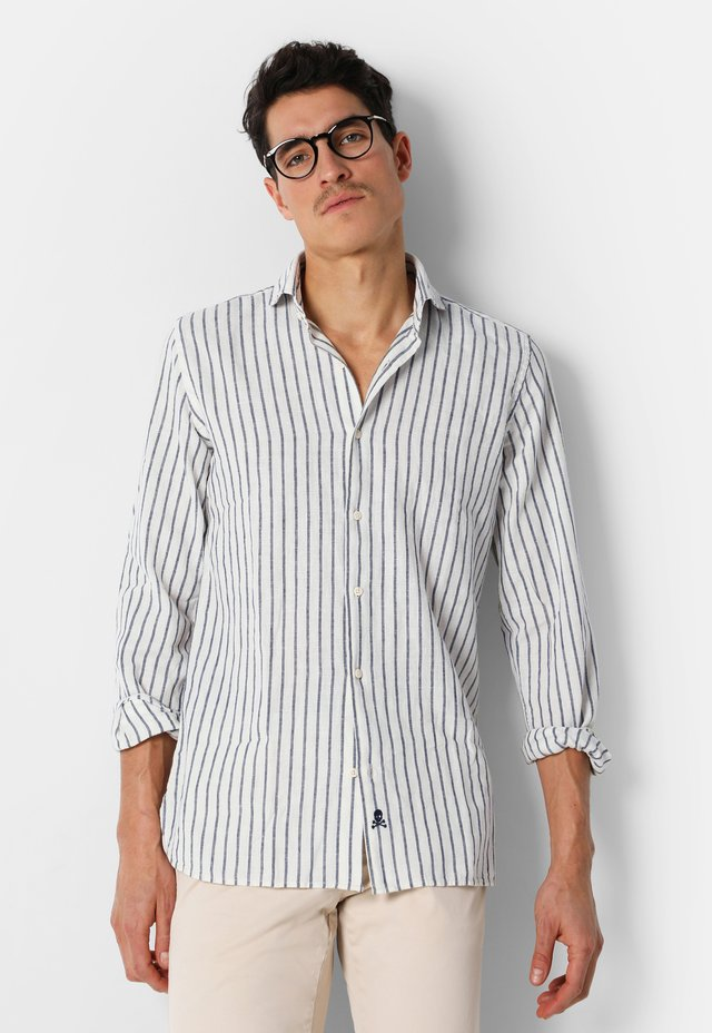 WITH SKULL ON THE HEM - Camicia - blue stripes