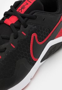 Nike Performance - LEGEND ESSENTIAL 2 - Sports shoes - black/university red/white - 5