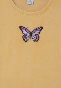 Lindex - VIOLA - Print T-shirt - light dusty yellow - 2