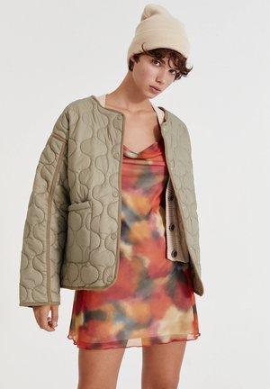 MIT TASCHEN - Down jacket - beige
