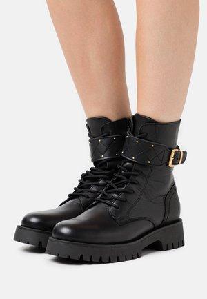 BOOTS  - Platform ankle boots - black/gold
