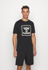 Hummel - HMLISAM - Print T-shirt - black - 0