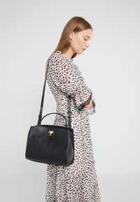 kate spade new york - MEDIUM SATCHEL - Handbag - black - 1