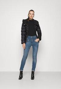 Liu Jo Jeans - RAMPY - Jeans slim fit - denim blue dazed wash - 1
