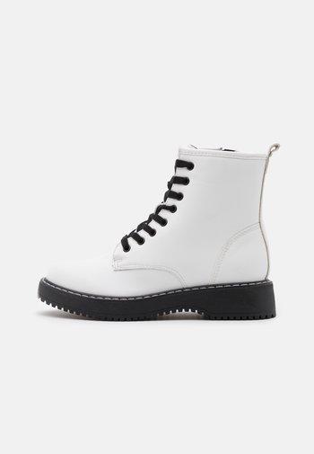 KURRT - Platform ankle boots - white paris
