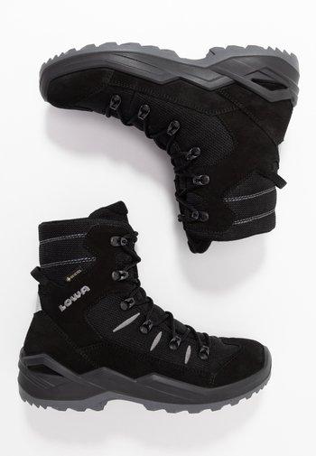 RUFUS GTX UNISEX - Winter boots - schwarz/grau