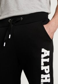 Alpha Industries - Trainingsbroek - black - 4
