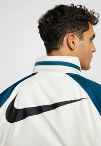Nike Sportswear - Summer jacket - light cream/nightshade - 6