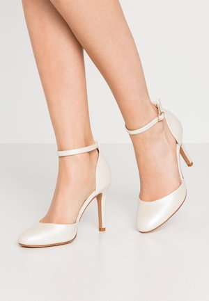 Klassiska pumps - white