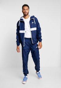 Nike Sportswear - Tracksuit - midnight navy/white - 1
