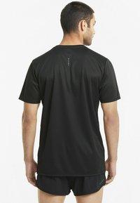 Puma - RUN FAVORITE TEE  - Print T-shirt - puma black - 2