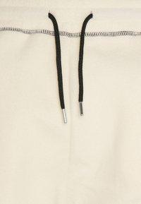 Mennace - CONTRAST STITCH JOGGER UNISEX - Tracksuit bottoms - off white - 2