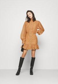 Missguided - PREMIUM BALLOON SLEEVE FRILL HEM MINI - Day dress - beige - 1