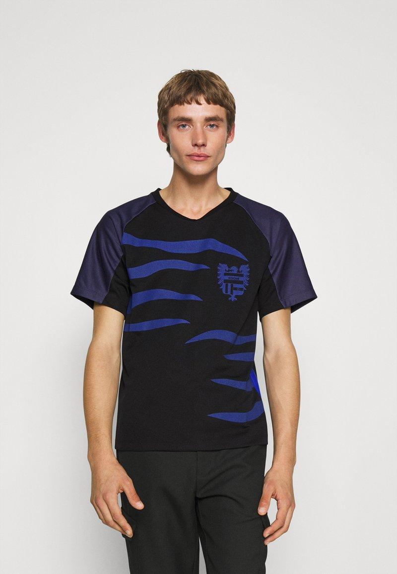 KOCHÉ - Camiseta estampada - black